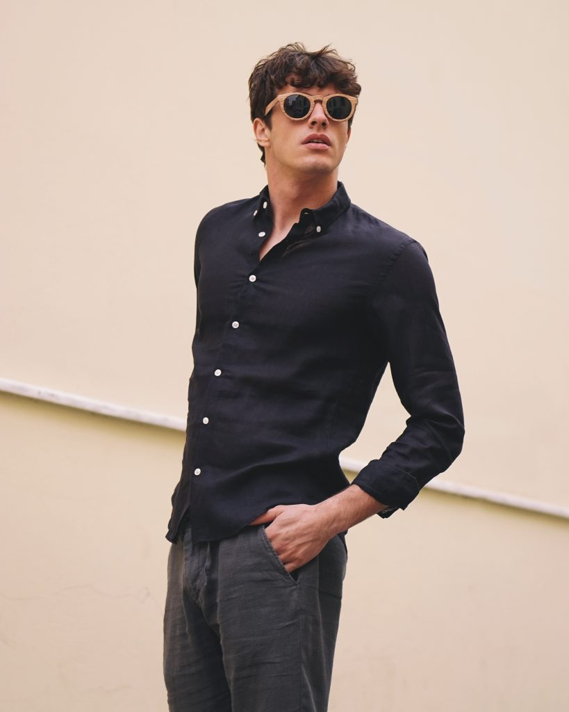 male model wearing black faros linen shirt
